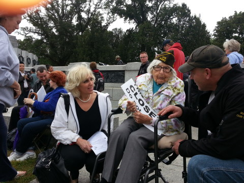 Taitz with 96 year old veteran who stormed the NAZI and Obama barricades